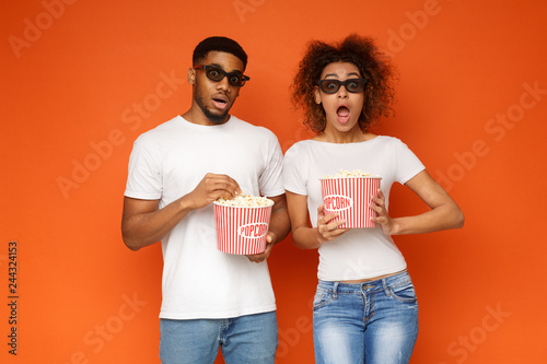 Shocked couple 3d glasses watching movie with popcorn Wallpaper Mural