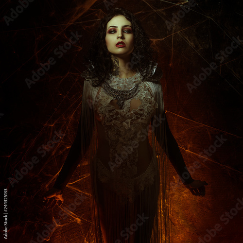 spider web vampire, demonic woman dressed in white lace and silver jewelry Fototapeta