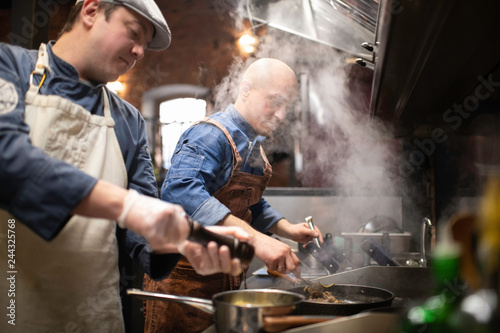 Chefs Preparing Food Together.. Canvas Print