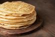 Leinwandbild Motiv Stack of russian pancake blini on a wooden background