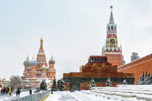 Red Square In Winter, Moscow, Russia. Lenin's Mausoleum By The Moscow Kremlin During Snowfall. This Place Is A Top Tourist Attraction Of Moscow. Panorama Of The Moscow Center With Famous Landmarks.
