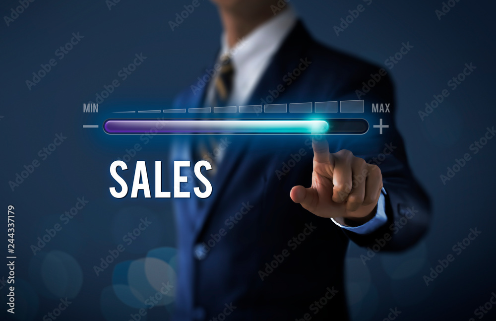 Fototapeta Sales growth, increase sales or business growth concept. Businessman is pulling up progress bar with the word SALES on dark tone background.