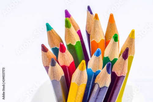 Fotografía  Colored pencils arranged in a group on white background