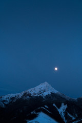 Velky Rozsutec 1609.7 m (5281.17 ft ) is a mountain situated in the Mala Fatra mountain range in the Zilina Region, Slovakia. Night Sky with moon shining mountain view.