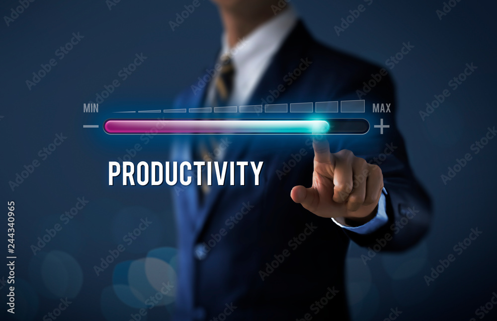 Fototapeta Increase productivity concept. Businessman is pulling up progress bar with the word PRODUCTIVITY on dark tone background.