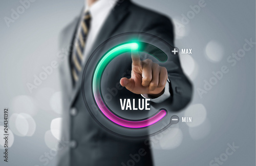 Fototapeta Growth value, increase value, value added or business growth concept. Businessman is pulling up circle progress bar with the word VALUE on bright tone background. obraz