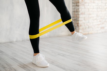 Girl Exercising Fitness Elastic Resistant Band, Close Up