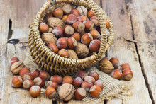 Nuts In A Basket On Old Wooden Background