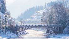 Winter Landscape With Bridge And River