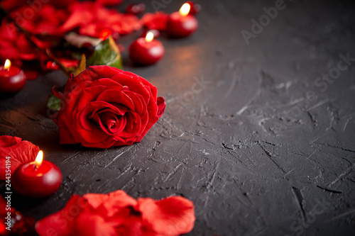 Fototapety, obrazy: Love and Valentines day concept. Red rose, petals, candles, dating accessories, boxed gifts, hearts, sequins on black stone background, frame composition, top view. Layout for greeting card