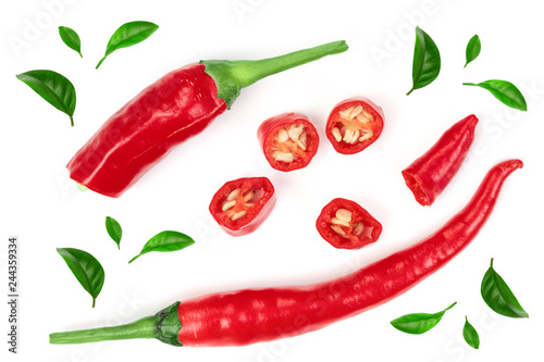 sliced red hot chili pepper decorated with green leaves isolated on white background. Top view. Flat lay pattern