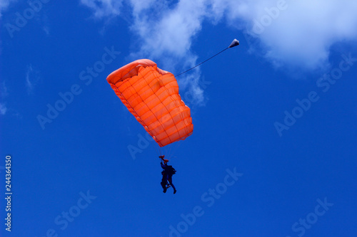Skydiver In Blue Sky. Active Hobby.Skydiving.Abstract Nature Background.