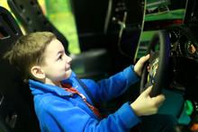 Boy Playing In Car Simulator