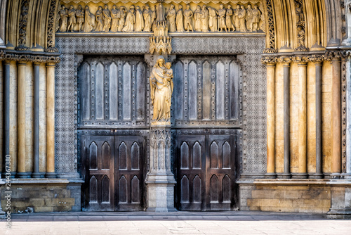 Fotografie, Obraz  London, United Kingdom famous Westminster Abbey closed large church doors facade