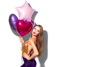 Beauty Fashion Model Party Girl With Pink Heart Shaped Air Balloons Posing. Beautiful Young Brunette Woman Portrait Over White
