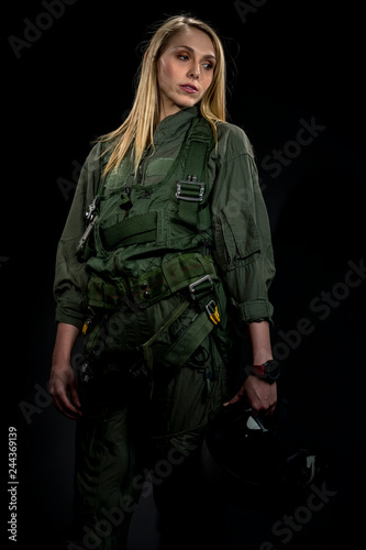 Beautiful Female Fighter Pilot Wearing A Flightsuit And Holding A Helmet In A St Canvas Print
