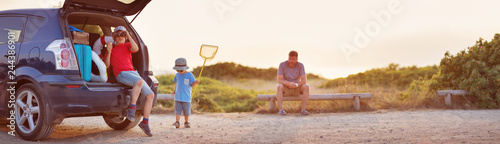 Family resting in nature at sunset