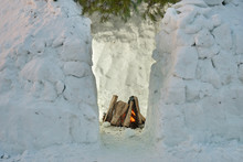 Bonfire Just Lit In A Snow House Igloo Just Built From The Snow Bricks