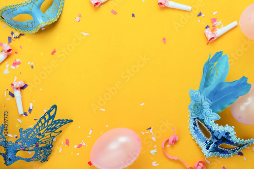 Spoed Foto op Canvas Carnaval Table top view aerial image of beautiful colorful carnival festival background.Flat lay accessory object the mask & decor confetti and balloon on modern yellow paper at home office desk studio.