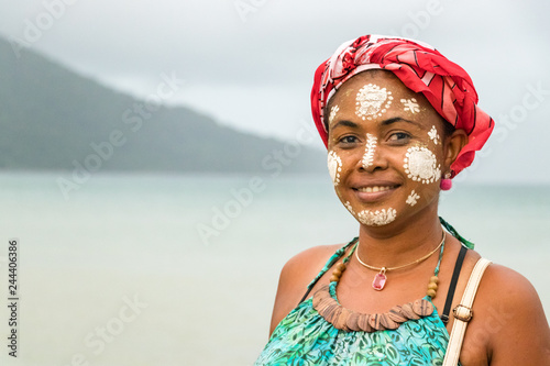 Stampa su Tela  Portrait of a Malagasy woman with her face painted, Vezo-Sakalava tradition, Nosy Be, Madagascar