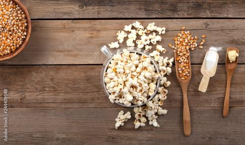 Fotografie, Obraz  pop corn bowl over wooden table