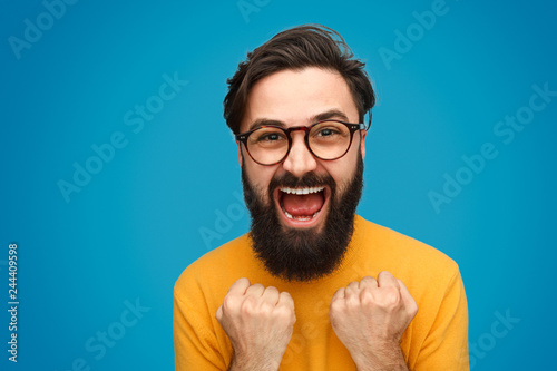 Bearded hipster celebrating victory Canvas Print