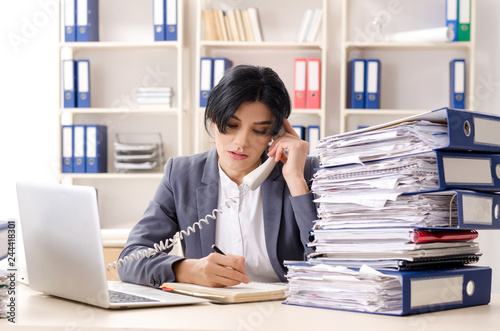 Middle aged businesslady unhappy with excessive work