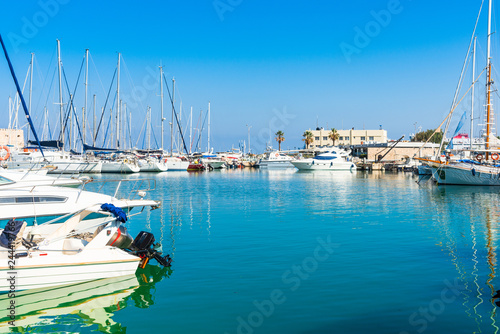 Crete, Heraklion city panoramic skyline view to luxury yachts anchored in the famous Venetian port marina.