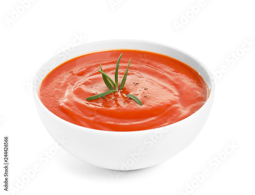 Bowl with fresh homemade tomato soup on white background