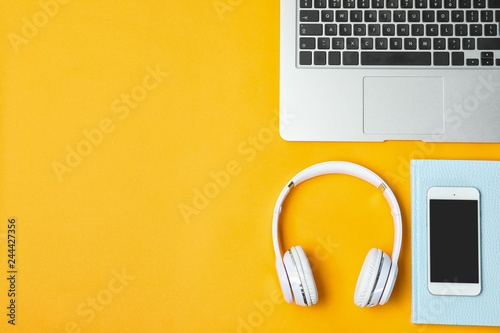 Fotografia  Flat lay composition with headphones, smartphone, laptop and space for text on c