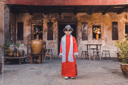 Poster Bordeaux Asian Chinese boy in Traditional Chinese New Year outfit celebrating Lunar New Year