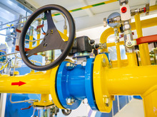 Compressor Station. Industrial Equipment. Yellow Pipes. Valve On The Pipe. Energy. Industrial Concept. Gas. Liquefied Gas.