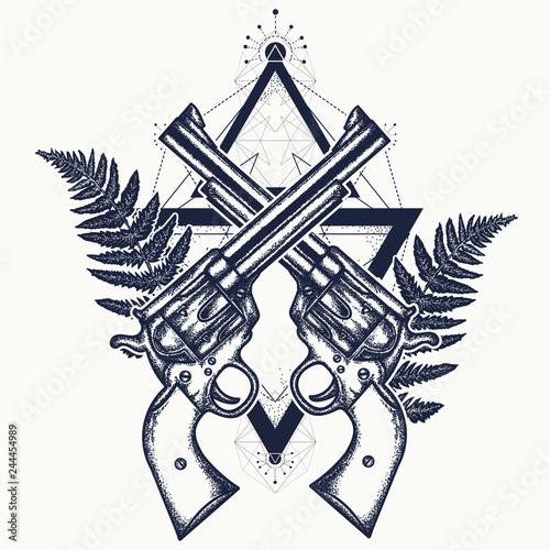 Photo  Magic crossed guns and fern tattoo
