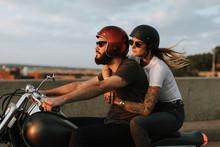 Biker Couple Riding Down The R...