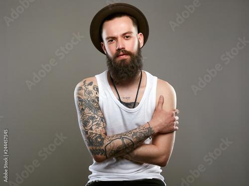 Fototapeta Tattooed handsome Bearded Man in Hat obraz