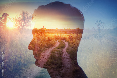 Obraz Man silhouette on rural landscape background. Psychiatry and psychology concept. - fototapety do salonu