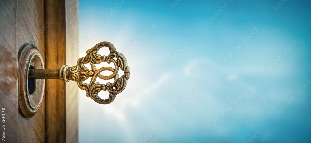 Fototapety, obrazy: Old key in keyhole on sky background with sun ray . Concept, symbol and Idea for History, business, security, religion background.