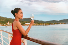 Luxury Cruise Ship Travel Elegant Asian Woman Drinking Wine Glass Drink Enjoying Watching Sunset From Boat Deck Over Ocean In Summer Vacation Destination. Cruising Sailing Away On Holiday.