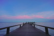 Beautiful jetty walkway on the sea in twilight time.