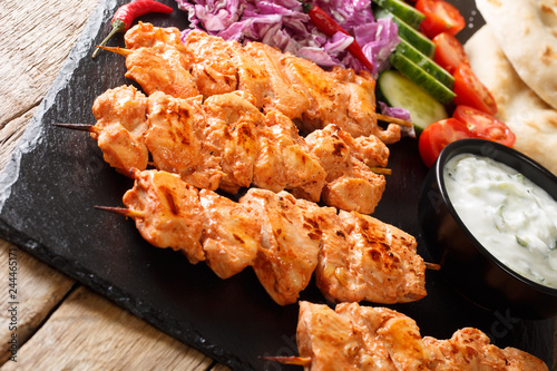 Lebanese Shish Taouk (Tawook)with fresh vegetables, yogurt sauce and pizza close-up. horizontal