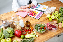 Dietitian Writing Diet Plan, V...