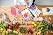 Dietitian Writing Diet Plan, V...