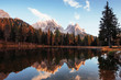 Deep autumn. Gorgeous mountains in clouds. Great landscape. Woods near the lake