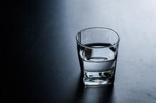 Glass Of Water On Black Backgr...