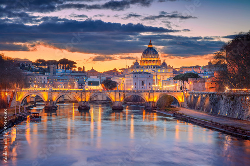 Cityscape image of Rome and Vatican City with the Saint Peter Basilica during beautiful sunset Canvas