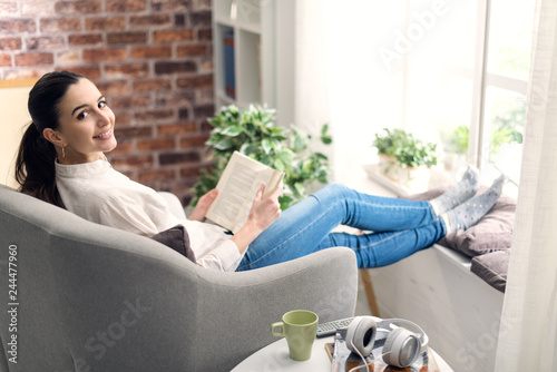Woman relaxing and reading a book