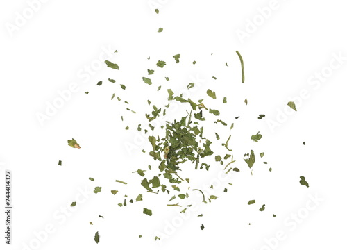 Chopped dry parsley leaves, pile isolated on white background, top view