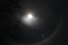 Moon Halo Phenomenon. Bright Ring Around The Moon Effect. Amazing And Mysterious Astronomical Phenomenon Over The Night Sky
