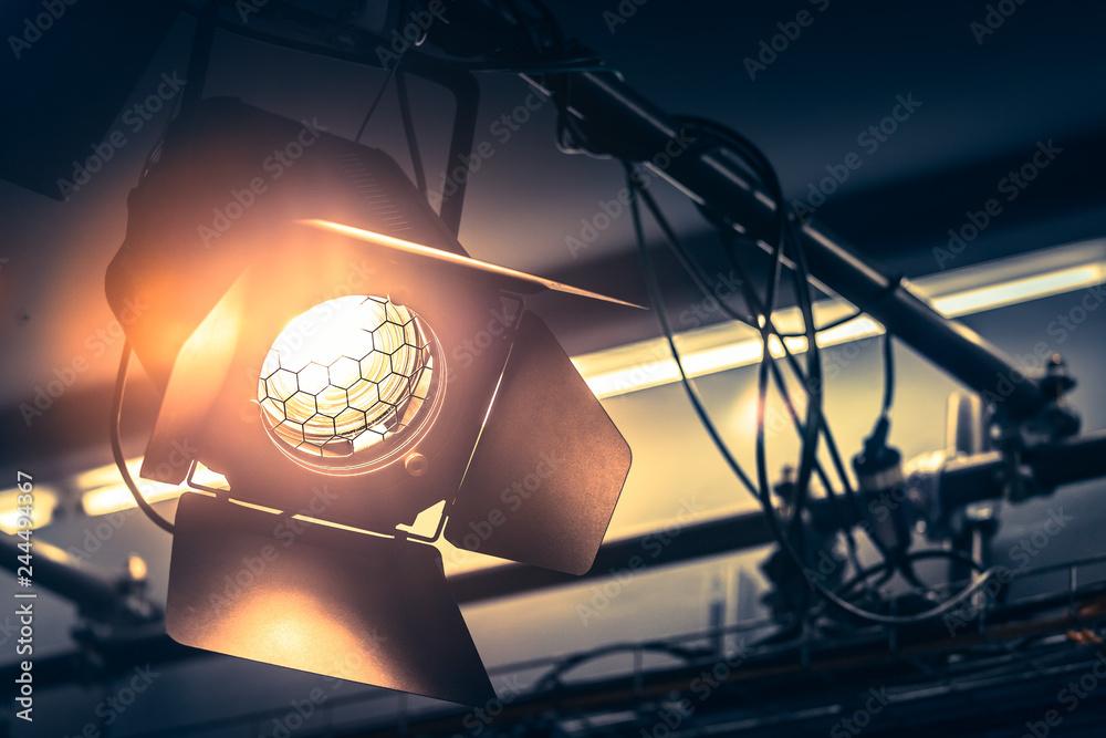 Fototapety, obrazy: Professional orange studio spotlight in a TV studio.