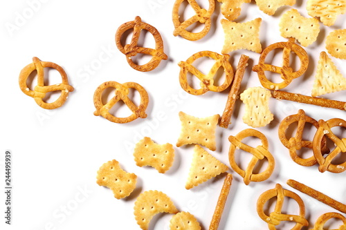 Valokuva  Salty cracker pretzel party mix isolated on white background, top view